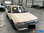 1989 Cream Ford Laser Sedan