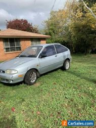 98 FORD FESTIVA TRIO CAR  AUTOMATIC GREAT RUN ABOUT OR  FIRST CAR HATCHBACK