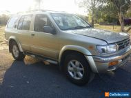 Nissan pathfinder 4x4 suv, dual fuel,gold ,sunroof.
