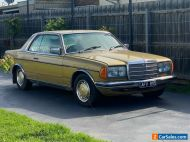 1977 GOLD MERCEDES BENZ COUPE 280 CE