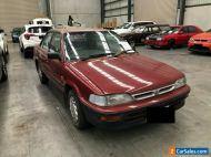 1993 Red Holden Nova Sedan