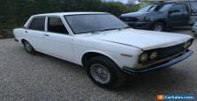 Datsun 1600 sedan. Manual, twin carbies, good floors, good project. Early model.