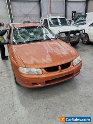 2001 Orange Holden Commdore Sedan